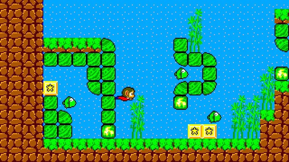 Alex Kidd swimming in a marine environment around fish and some mossy rock. You can switch between classic and remastered visuals at the press of a button