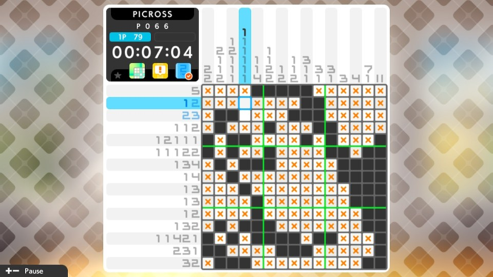 A puzzle nearly completed with black tiles and x spots.