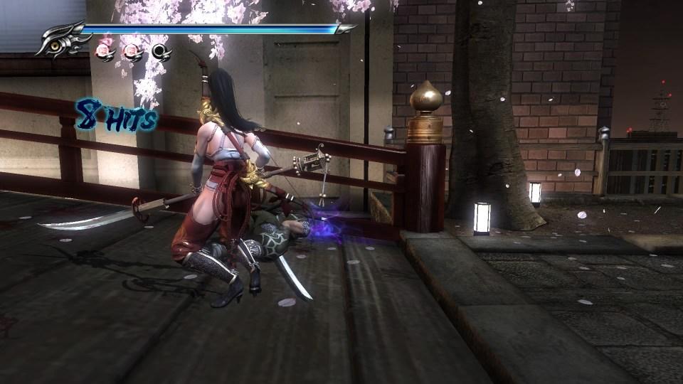 Momji walking around a dead body in Ninja Gaiden Sigma 2