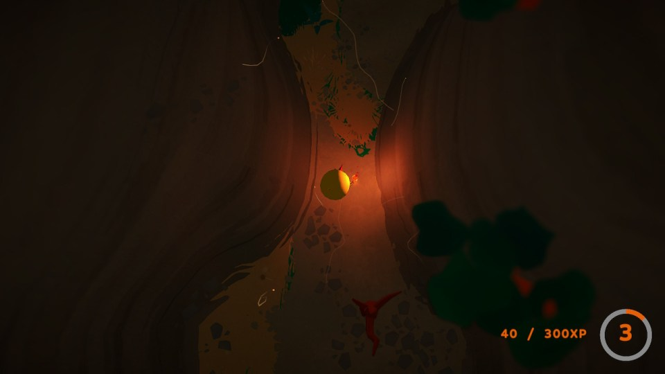 Flint walks through a thin canyon at night with a glowing torch.