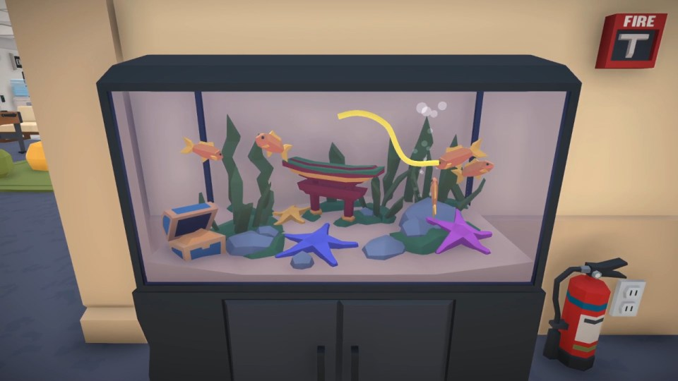 Freddy Spaghetti swimming in a cartoony fish tank with several goldfish.  Freddy Spaghetti 2 PS5 Review for Rapid Reviews UK
