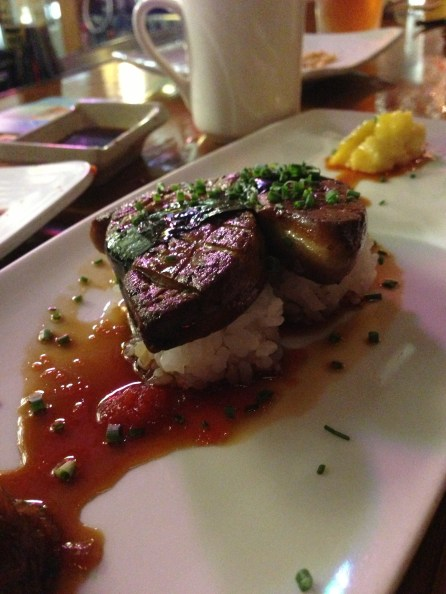 Seared foie gras served with caramelized Maui onions, ripe mango and unagi glaze drizzle.