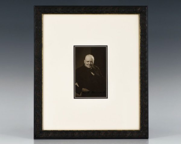 "Black and white photograph of Prime Minister Winston Churchill. Boldly signed ""Winston S. Churchill."""