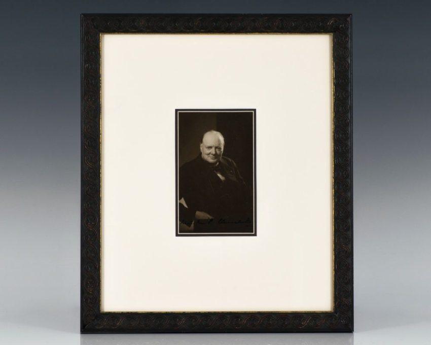 "Black and white photograph of Prime Minister Winston Churchill. Boldly signed ""Winston S. Churchill."""