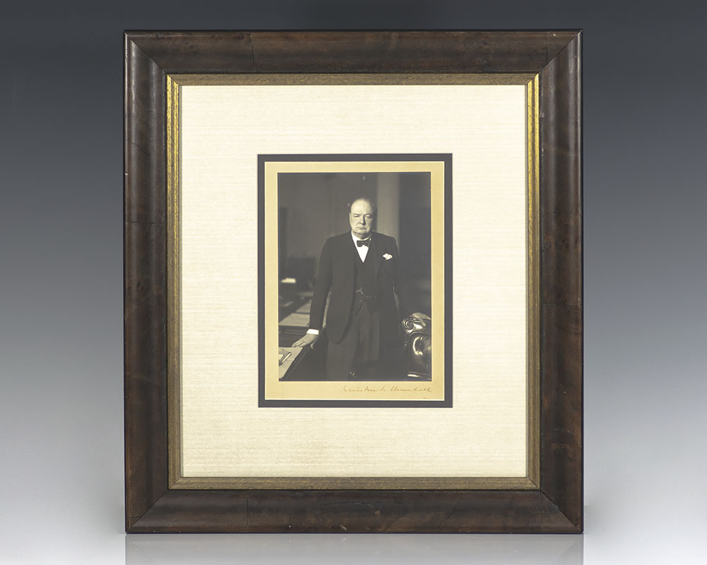 Rare portrait of Sir Winston Churchill by Walter Stoneman; boldly signed by Churchill