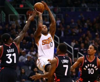 Feb 2, 2016; Phoenix, AZ, USA; Phoenix Suns forward P.J. Tucker (17) shoots the ball in the second quarter against the Toronto Raptors at Talking Stick Resort Arena. Mandatory Credit: Mark J. Rebilas-USA TODAY Sports