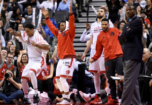 Apr 12, 2016; Toronto, Ontario, CAN; Toronto Raptors guards DeMar DeRozan (10), Kyle Lowry(7), center Jonas Valanciunas (17) and teammate Cory Joseph (not dressed for game) celebrate a basket during second half play against Philadelphia 76ers. at Air Canada Centre. The Raptors won 122-98. Mandatory Credit: Dan Hamilton-USA TODAY Sports