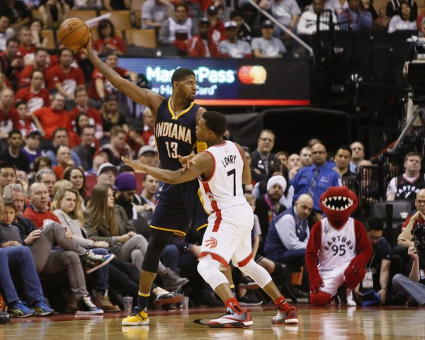 Apr 16, 2016; Toronto, Ontario, CAN; Indiana Pacers forward Paul George (13) keeps the ball away from Toronto Raptors guard Kyle Lowry (7) in game one of the first round of the 2016 NBA Playoffs at Air Canada Centre. Indiana defeated Toronto 100-90. Mandatory Credit: John E. Sokolowski-USA TODAY Sports