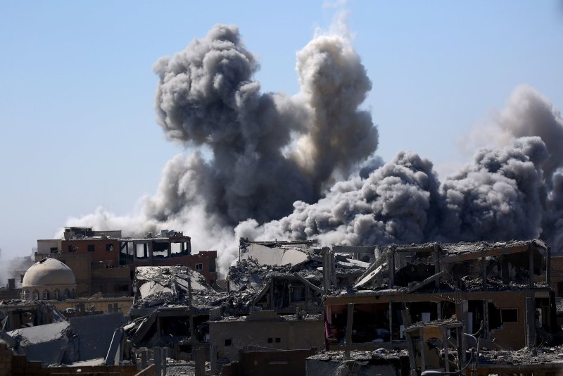 Smoke billows in Raqqa on Sept. 3, 2017, as Syrian Democratic Forces, a U.S. backed Kurdish-Arab alliance, battle to retake the city from the Islamic State group. Delil Souleiman/AFP/Getty Images
