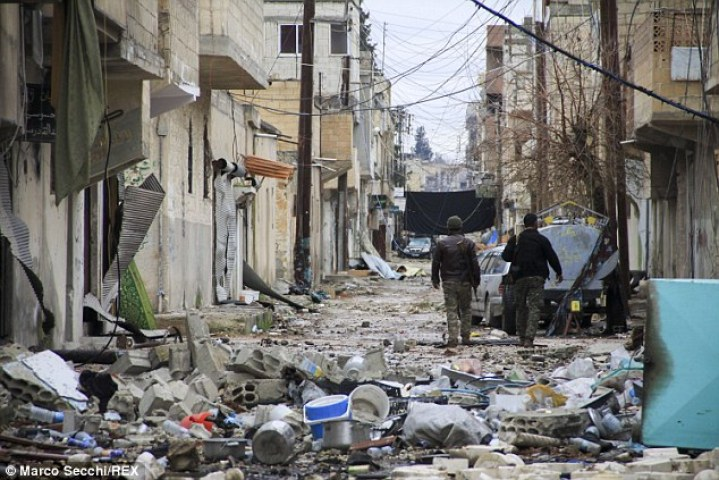 Loss: News of the defections comes just weeks after ISIS was forced to pull out of the besieged Syrian city of Kobane (pictured) after it became little more than a vortex of death for the terror group