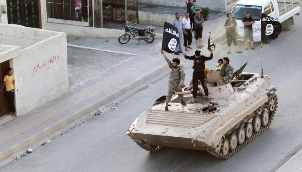 Reuters Militant Islamist fighters take part in a military parade along the streets of northern Raqqa province, June 30, 2014.