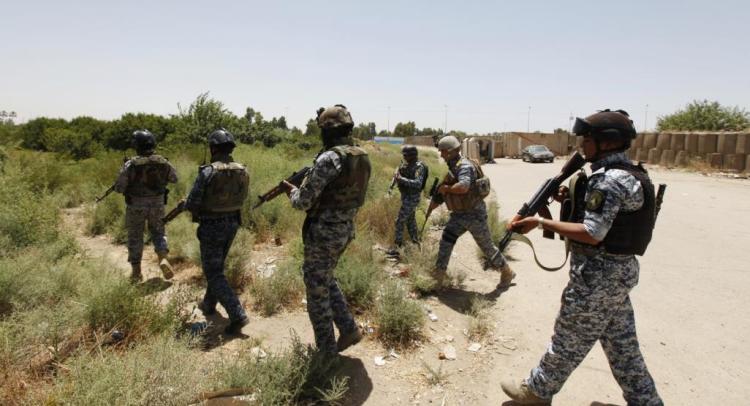 قوات عراقية أثناء عمليات مداهمة سابقة (رويترز-أرشيف)
