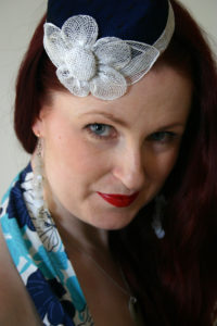 Lori wearing a hat by Sakura Millinery