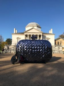 Staff repairing the giant replica Bottega Veneta clutch bag outside Chiswick House