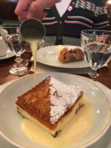 Eleanor pouring cr�me anglaise on her Topfenstrudel