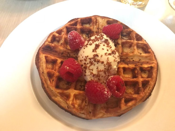 Eleanor's waffles with raspberries and whipped cream at Berners Tavern