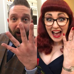 Lori and Topper show off their wedding rings