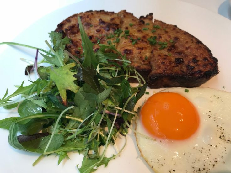 Welsh rarebit on sourdough, served with a fried egg and mixed leaf salad