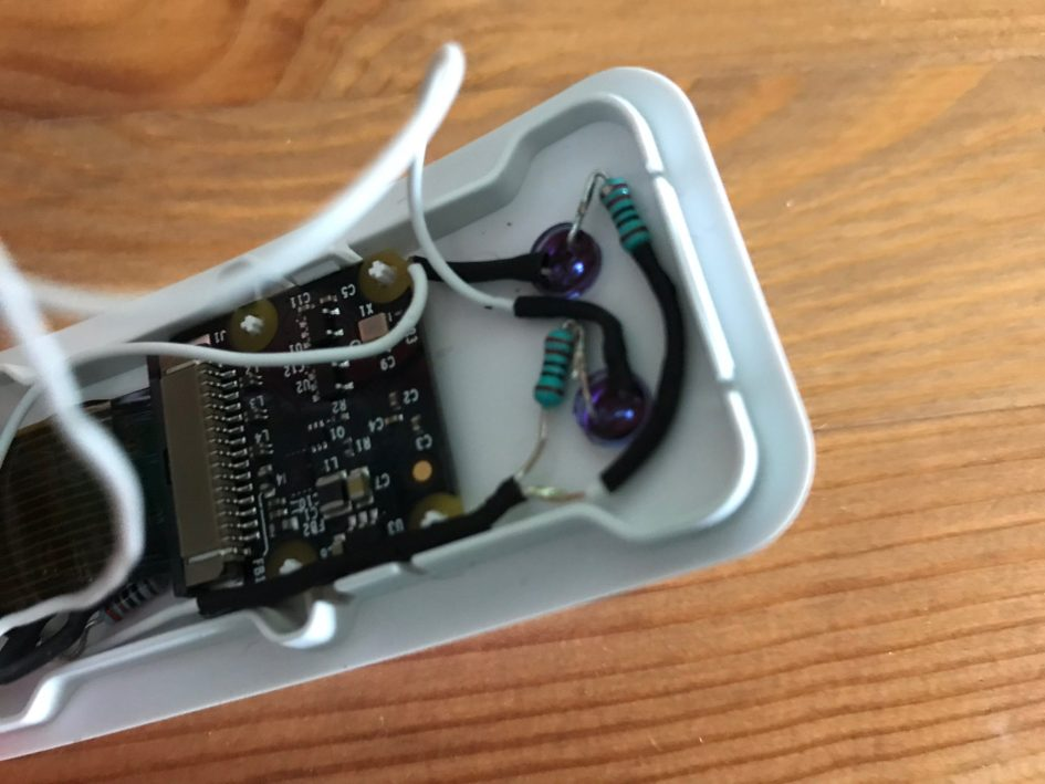 A close up of the I R L E D circuit, inside the Raspberry Pi Zero case.
