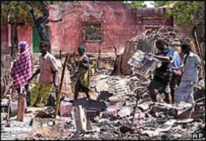 Group of Somali youth standing on the rubbles of their of home