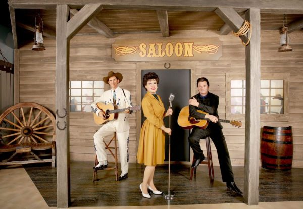 Hyperbolic Exaggeration: photo of wax figures of Patsy Cline with hank Williams and Johnny Cash from Tussauds.
