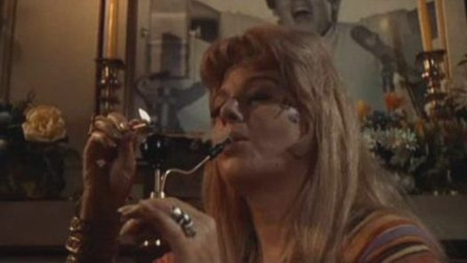 "Sociopolitical satire: photo of Shelly Winters toking up in the movie ""Wild in the Streets."""
