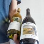 How To Hold Two Bottles Of Wine In One Hand