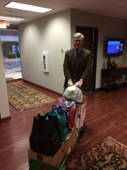 Ratliff & Taylor collected donations of warm clothing and sundries and delivered them to homeless Veterans