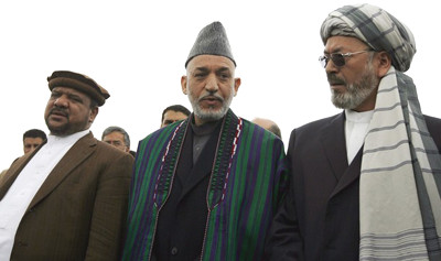 Hamid Karzai with notorious warlords Mohammed Qasim Fahim and Muhammed Karim Khalili, both of which now hold positions in Karzais government (photo from RAWA.org).