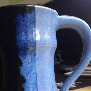 Blue Mug with a cold killer hot drink