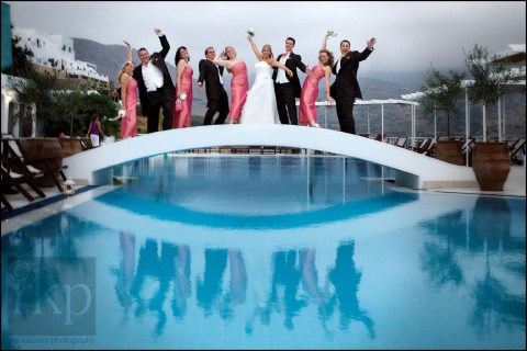 Bridal party over pool in Amorgos