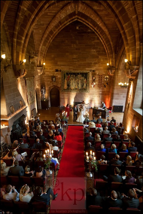 Bride and Groom prepare to walk down the aisle at Peckforton Castle