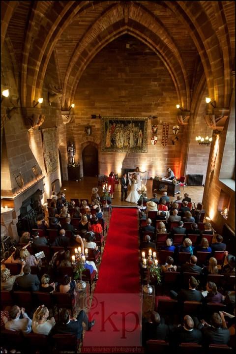 Bride and Groom prepare to walk down the aisle at Peckforton Castle