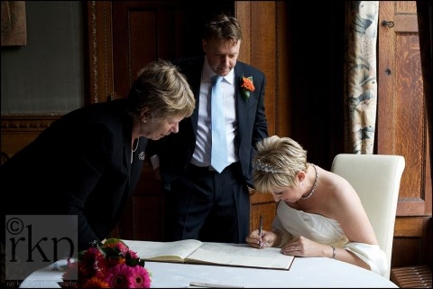 Bride signing the register at Soughton Hall