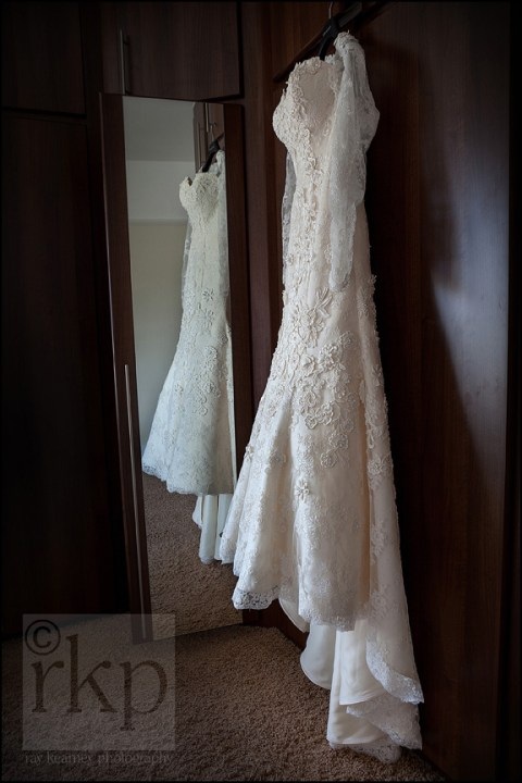 Bridal dress hanging on wardrobe