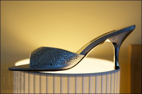 Bride's shoe sitting on table lamp