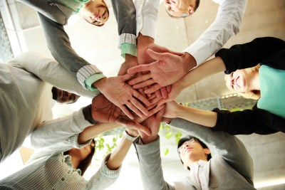 business people teamwork in an office with hands together