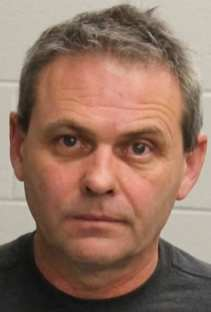 KENNETH HARRINGTON, AGE 52, OF MIDDLEBORO, was arrested on a charge of OUI after getting into a car crash and fleeing on foot Sunday night, Jan. 22. (Raynham Police Department)