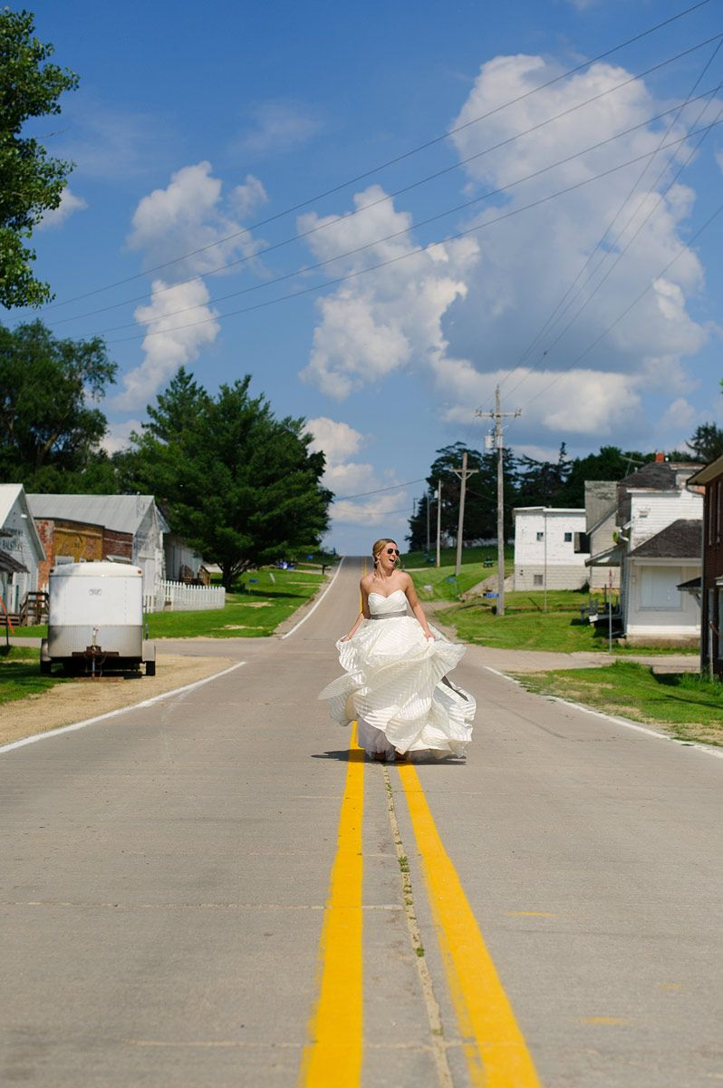 Bride posing in the middle of the road