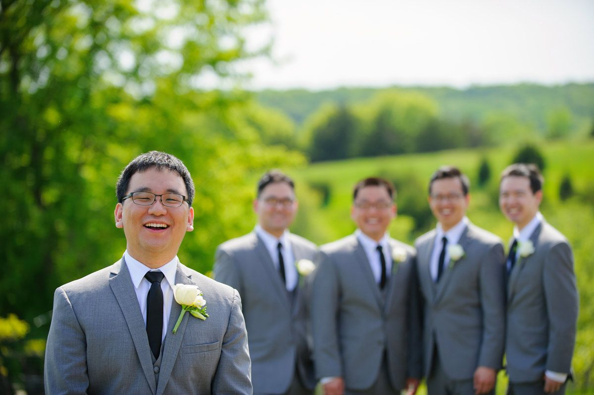 Photo of the groom with his groomsmen in the background