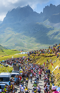 Col du Glandon, France - 23 July 2015: The peloton riding in a beautiful curve at Col du Glandon in Alps during the stage 18 of Le Tour de France 2015.