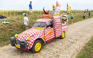 Quievy,France - July 07, 2015: Cochonou Caravan during the passing of the Publicity Caravan on a cobblestoned road in the stage 4 of Le Tour de France on July 7 2015 in Quievy, France. Cochonou is an important French brand of short dry sausages.