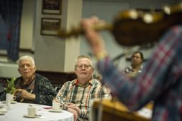 Residents enjoy a traditional tune played by fiddler Alistair McCulloch on the 267-year-old Gregg Violin, a Scottish national treasure that toured the U.S. in January. (Alex Rogals | Staff)