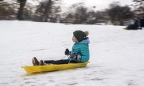 Hannah Boyle, 9, of Brookfield, sleds down the hill on Saturday, Feb. 15, 2020, at the Swan Pond hill in Riverside.