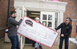 The folks at Paisan's Pizzeria in Brookfield donated ,000 to the Hauser PTO on Feb. 26, 2020, during the 50th annual food drive kickoff event at L.J. Hauser Junior High School in Riverside. | ALEX ROGALS/Staff Photographer