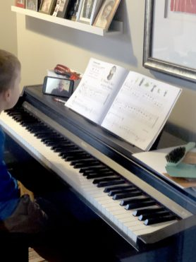 Piano student Fred Cherne takes a virtual lesson with instructor Tim Egan of A Sound Education last week. | Photo courtesy of A Sound Education