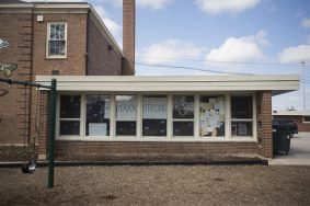 Blue hearts surround a #MaxxStrong sign and a sign with Maxx Kusper's baseball team number on the windows facing Washington Avenue at Hollywood Elementary School on April 1 in Brookfield. | ALEX ROGALS/Staff Photographer