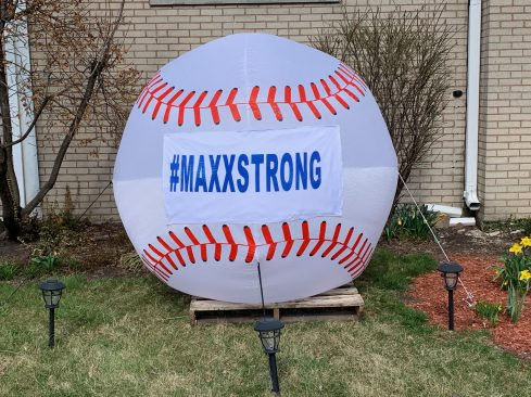 Sue and Jim Episcopo hauled out a giant inflatable baseball, with a #MaxxStrong hashtag on it, and placed it on their front lawn as a show of support for Maxx Kusper and his family. (Provided)