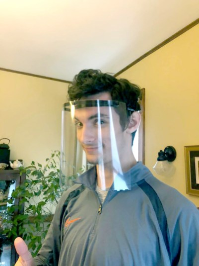 Tim Pipal shows off one of the face shields he made on his 3D printer at home. (Photo courtesy of Sue Pipal)