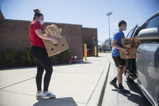 Lidia Bielobradek, left, loads unclaimed lunches from Riverside-Brookfield High School and loads them in her van to bring to Housing Forward, an agency serving the homeless in the west suburbs, on April 20. | Alex Rogals/Staff Photographer